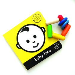 book and rattle for baby development