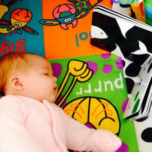 baby on playmat staring at Mesmerised black and white baby book