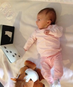 newborn on playmat with Mesmerised black and white book