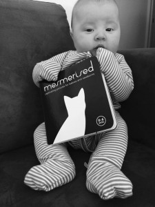 Baby holding recommended book for babies - Mesmerised