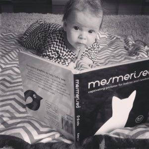Tummy time for baby with propped up book
